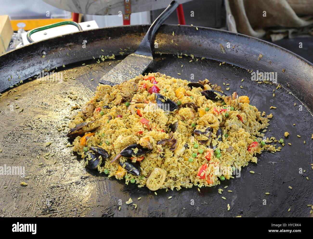 large pan of Spanish restaurant with tasty paella with rice and mussels and seafood Stock Photo