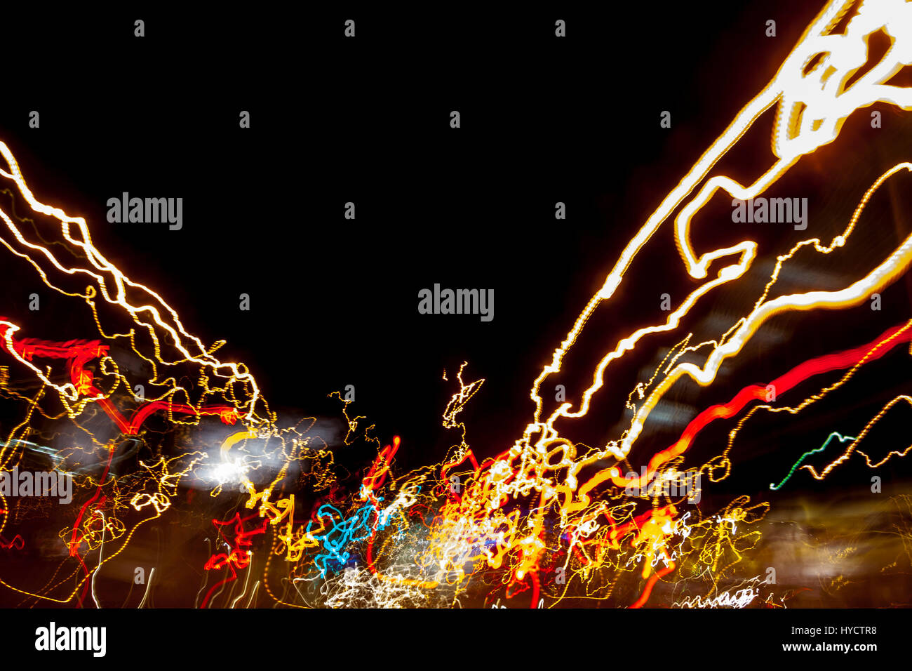 Multiple colorful light trails and streaks from auto tail lights and street lights motion blur - Stock Image