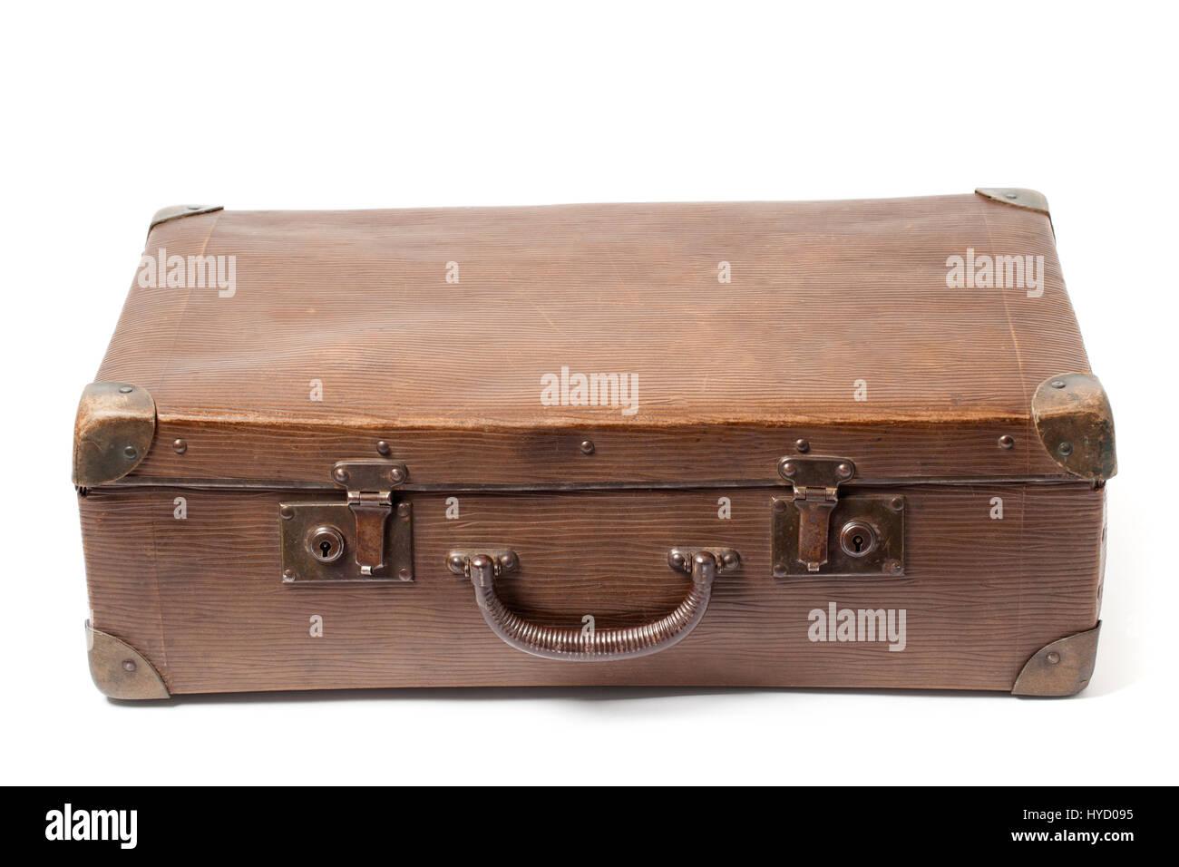 Closed obsolete suitcase isolated on white background. - Stock Image