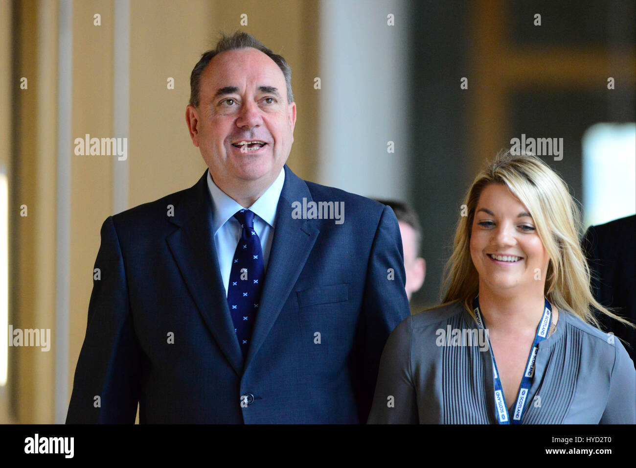 Scotland's First Minister Alex Salmond makes his way to the chamber of the Scottish Parliament to make a statement Stock Photo