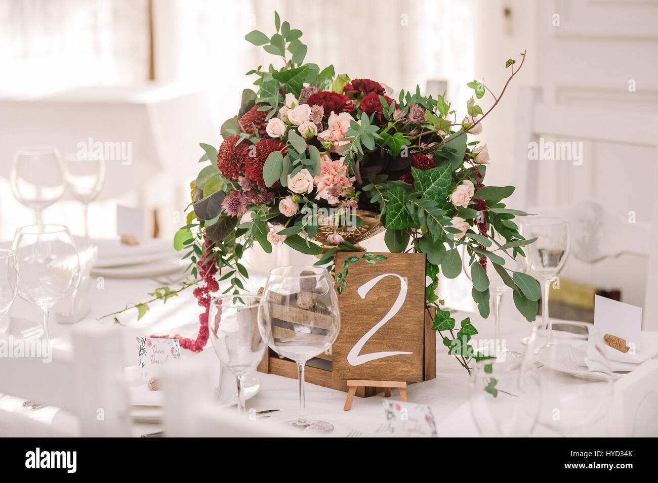 Wedding Table Decoration With The Red And Pink Flowers And Wooden