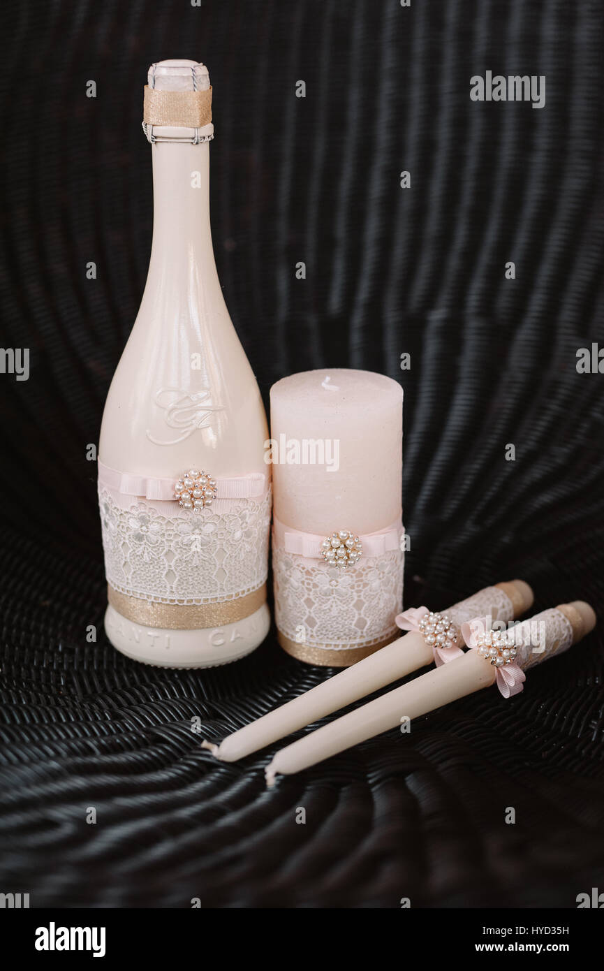 Wedding decorated candles and champagne in the tenderly light pink style - Stock Image