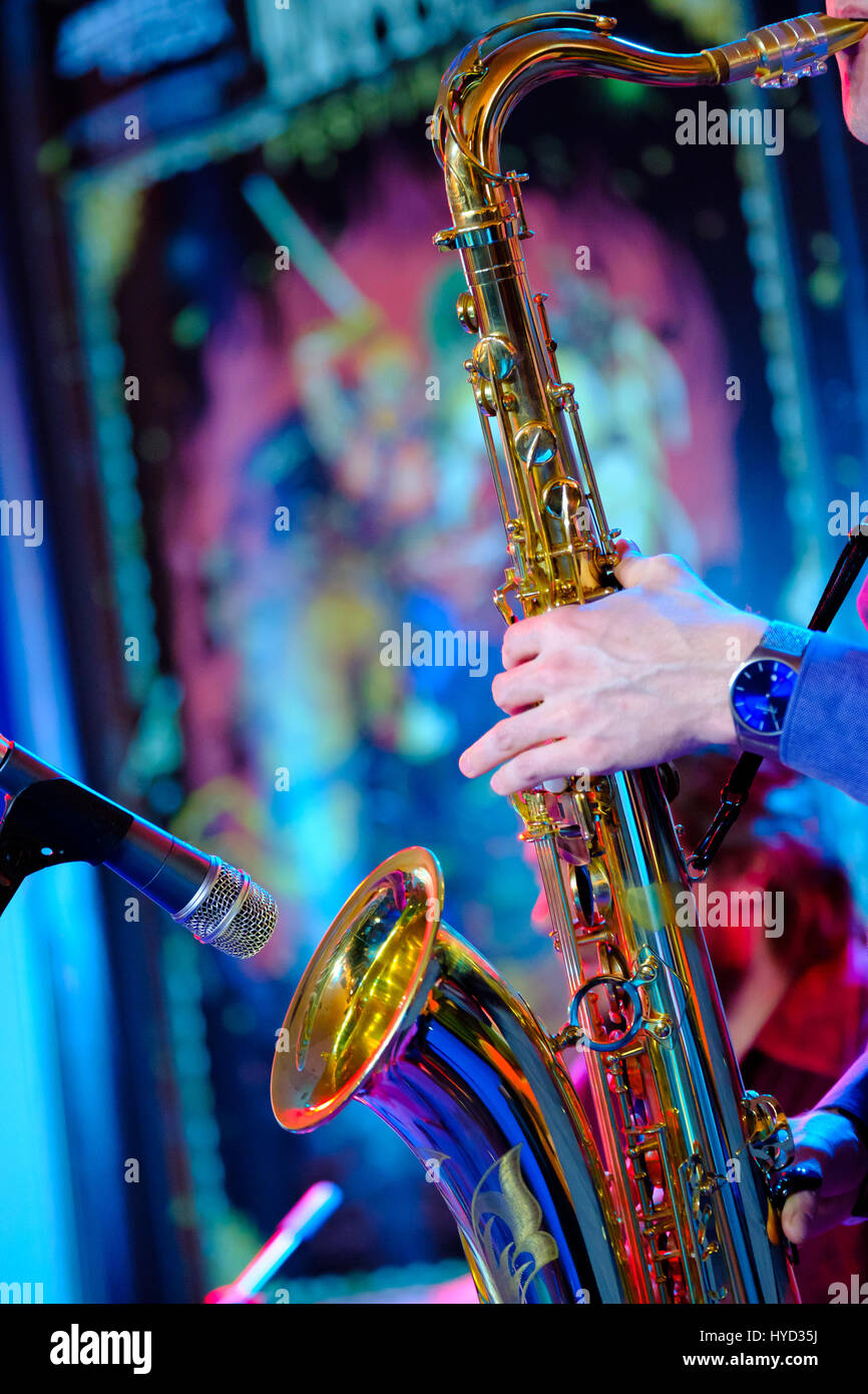 Musician plays the saxophone at the stage - Stock Image