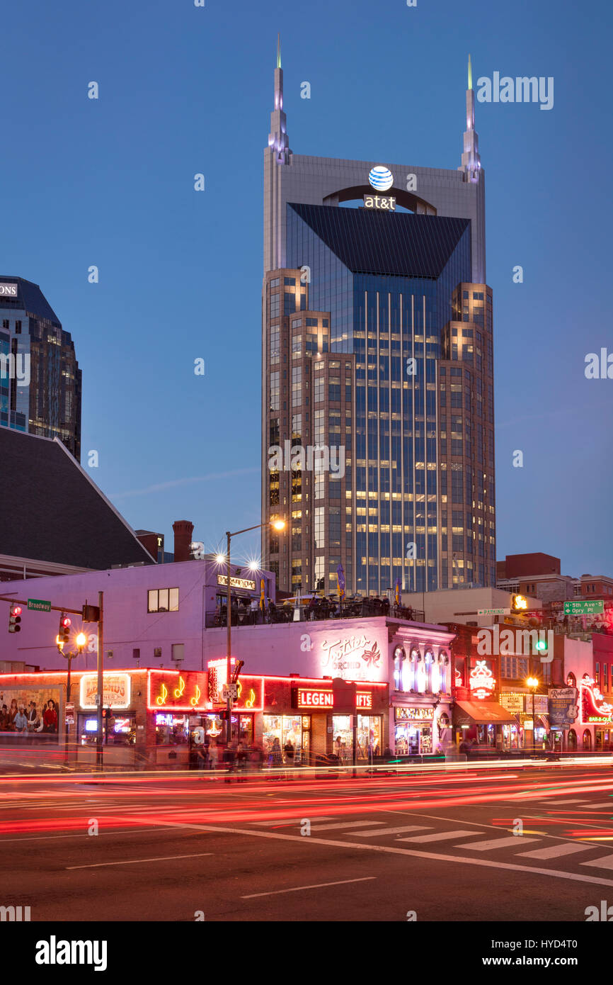 AT&T Building towers over music clubs along lower Broadway in downtown Nashville, Tennessee, USA - Stock Image
