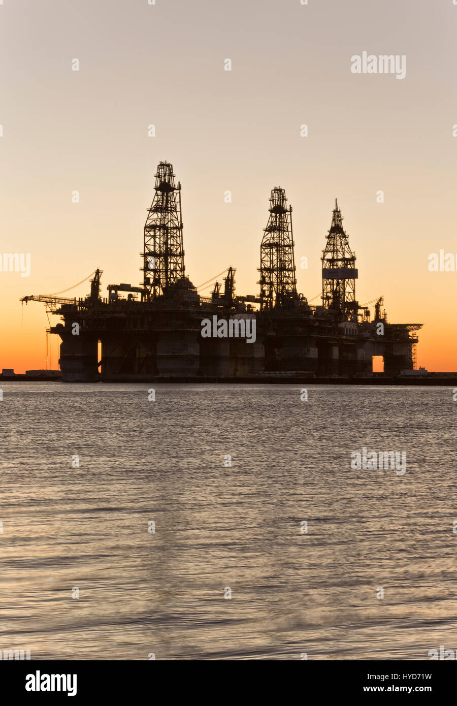Deepwater drill rigs temporarily in storage, sunset,  Harbor Island,  Canyon Port, Port Aransas. Stock Photo