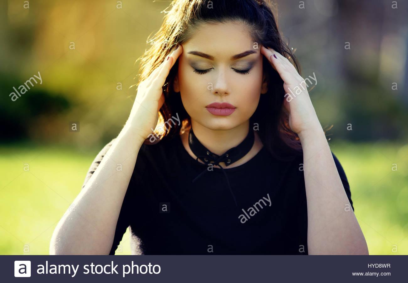 Sad Depressed Girl With Migraine Outdoor Portrait Stress And Stock Photo Alamy