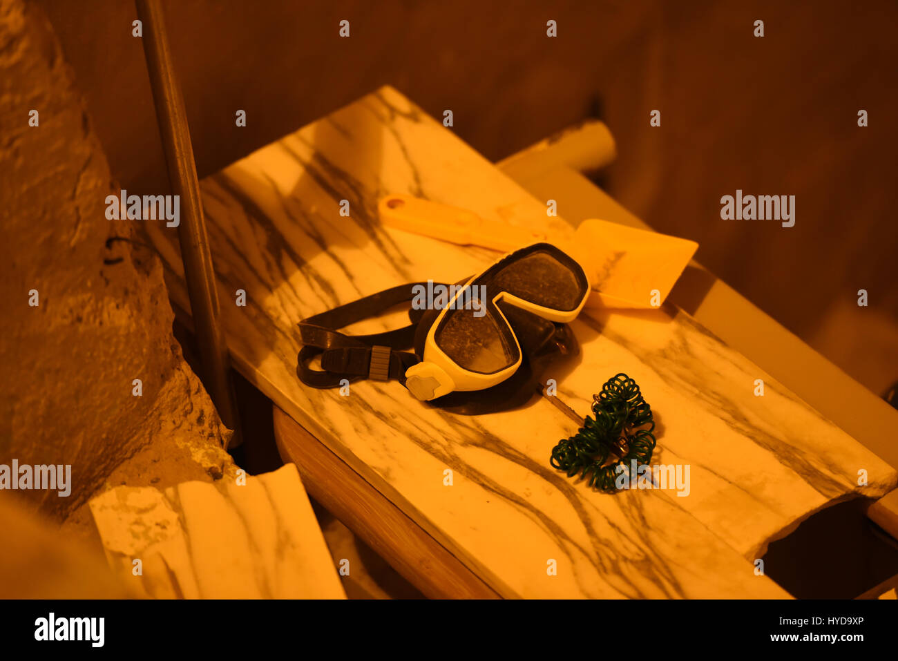 Diving goggles placed on a bench for tomorrow - Stock Image