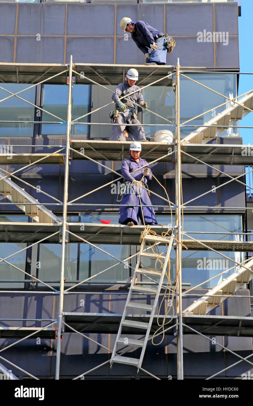 Scaffolders Working in a Construction Site in Kita-ku Tokyo Japan - Stock Image