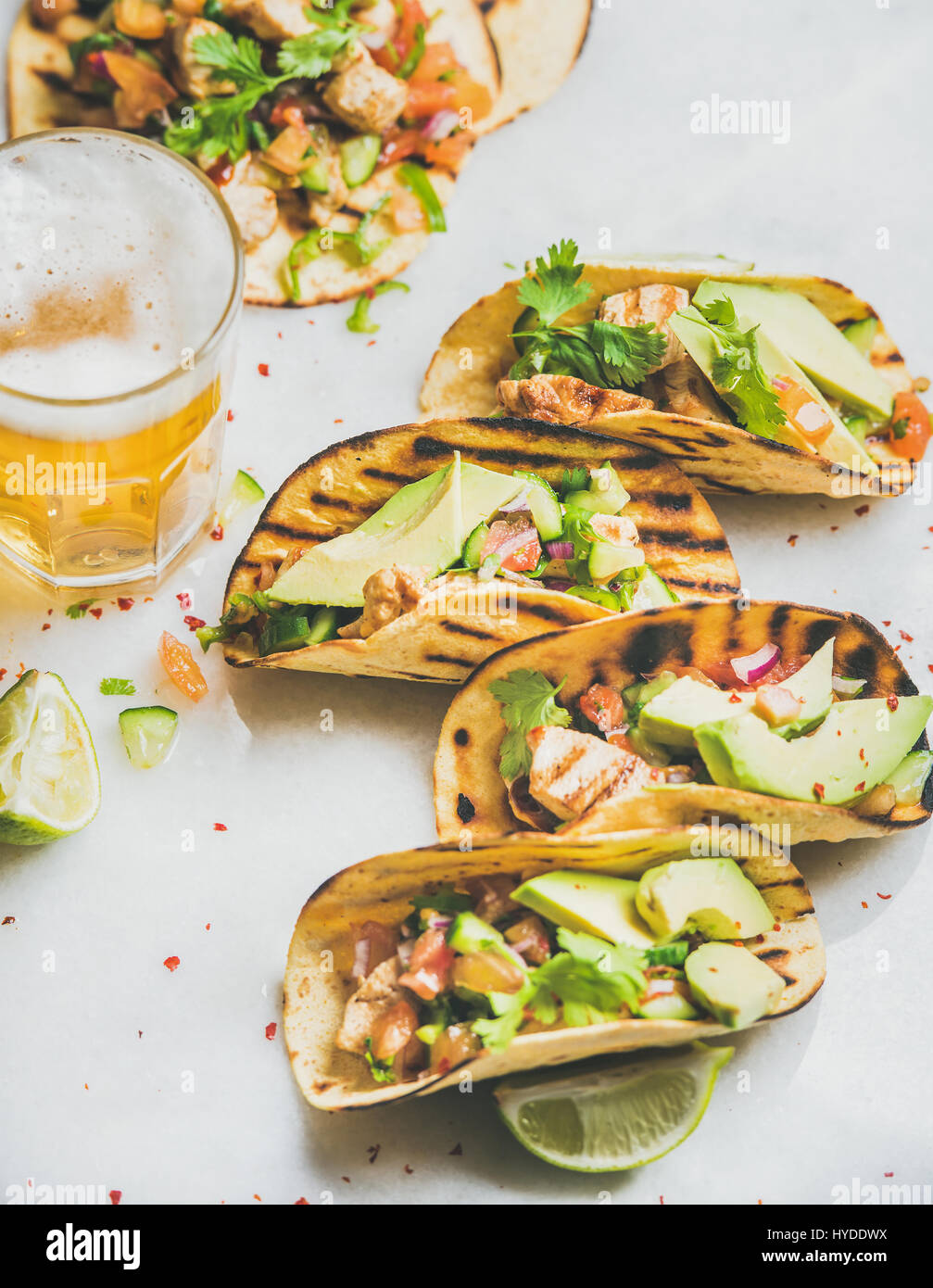 Healthy corn tortillas with grilled chicken fillet, avocado and beer - Stock Image
