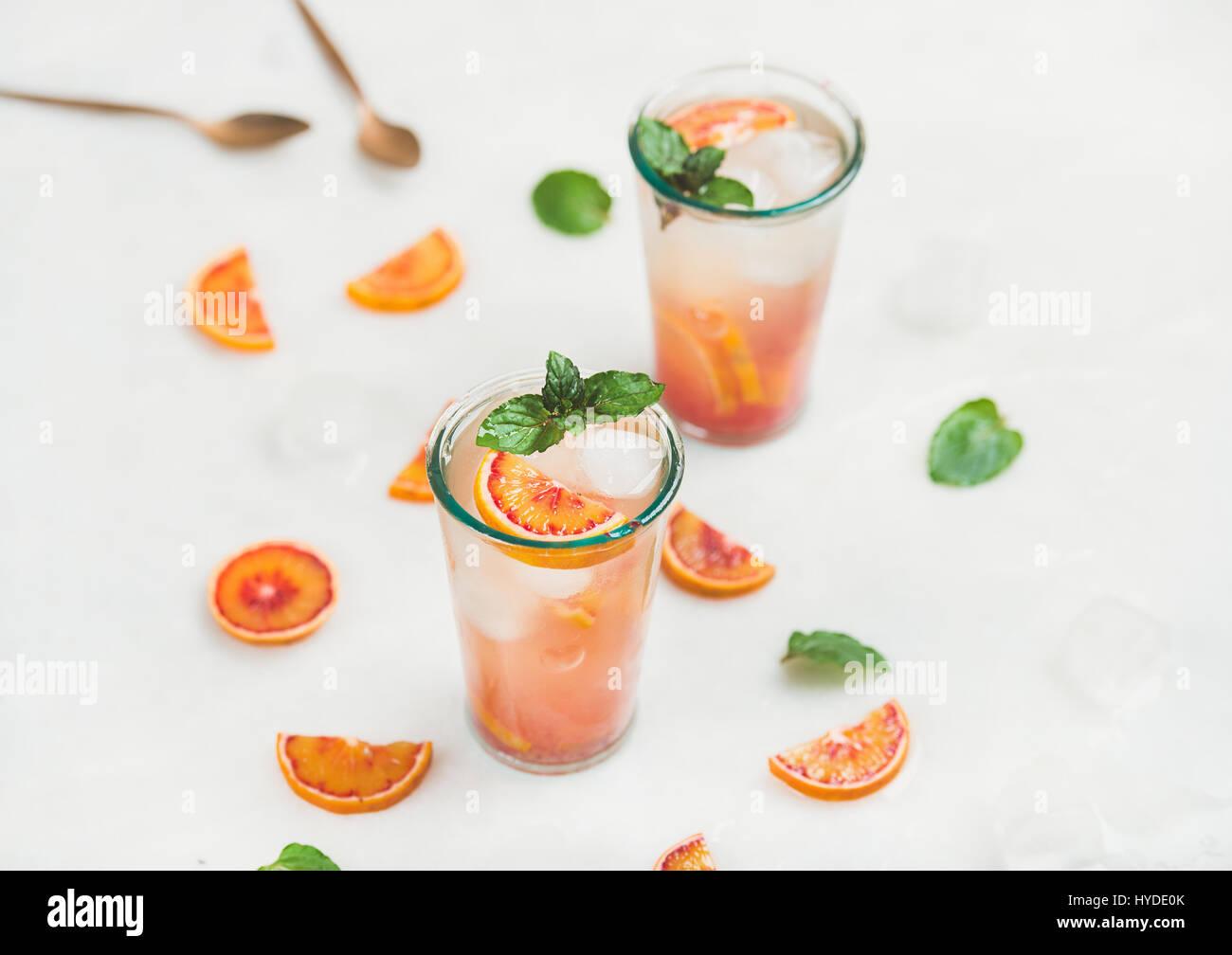Blood orange fresh summer lemonade with ice and mint Stock Photo