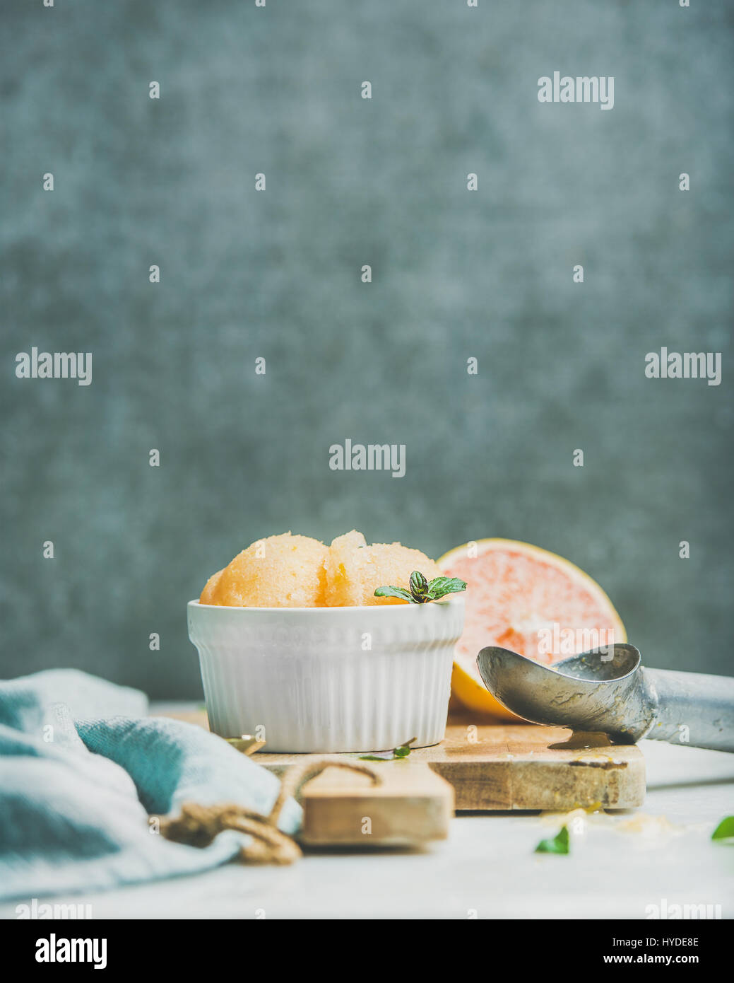 Pink grapefruit sorbet with mint in bowl, copy space - Stock Image
