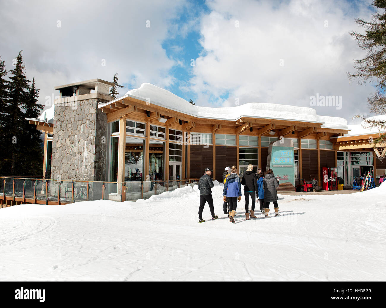 People in front of the day lodge at the Whistler Olympic Park. - Stock Image