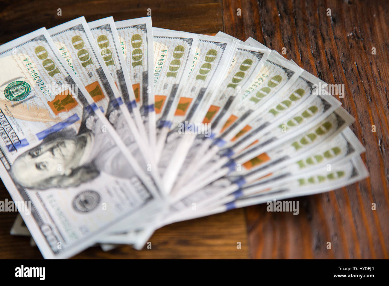 A stack of brand new one hundred dollar bills in US currency