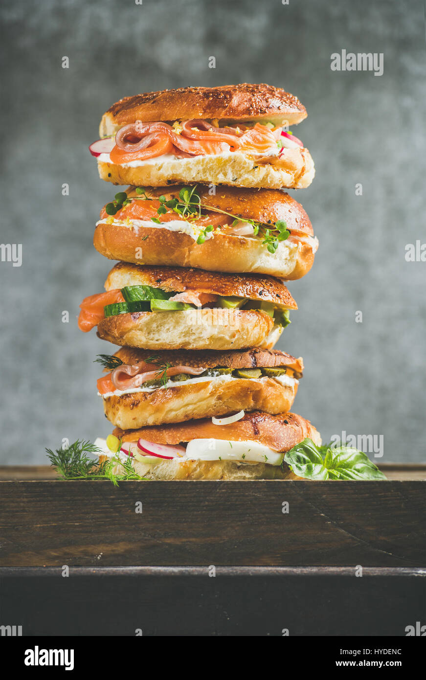 Close-up of Bagels heap with salmon, eggs, vegetables and cream-cheese - Stock Image