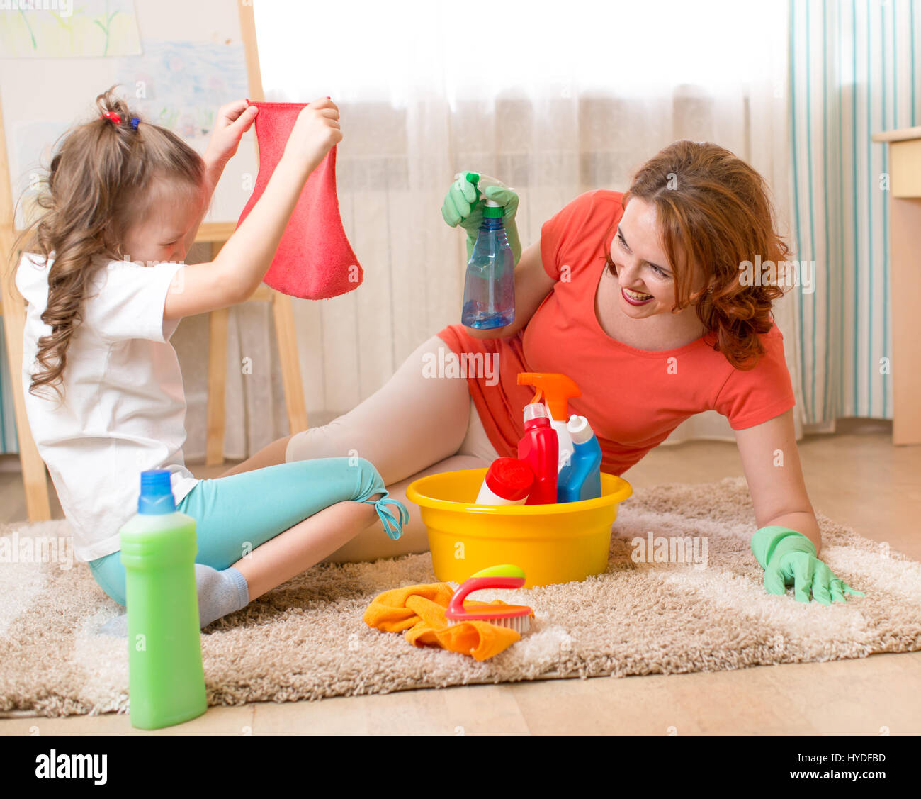 Woman and kid playing before housework - Stock Image