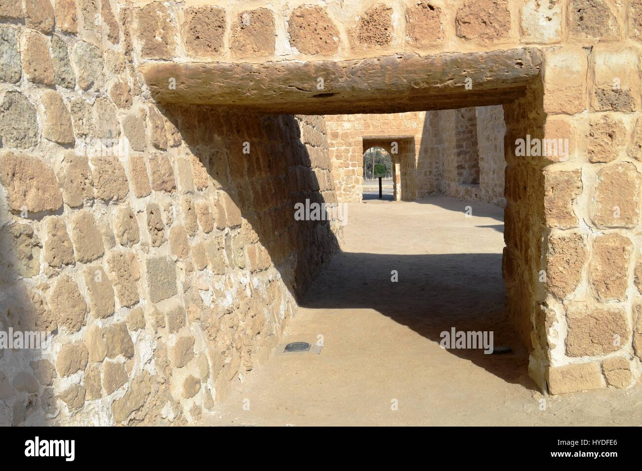Trapezoidal passage way feature inside the Bahrain Fort at Al Qalah, Bahrain, in the Middle East. - Stock Image
