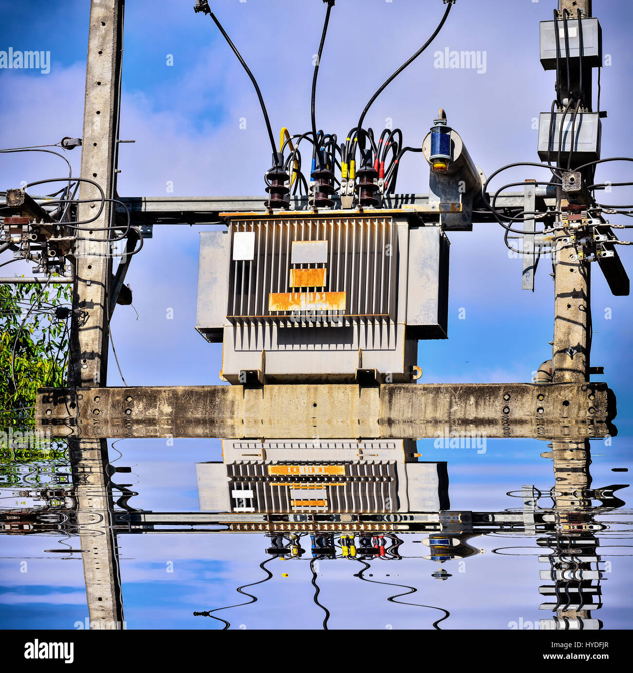 High voltage transformer on high power station with reflection Stock Photo