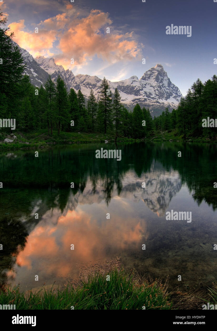 The Cervino - better known as Matterhorn outside Italy - and the tiny Lago Blu at sunset. Near to Breuil-Cervinia - Stock Image