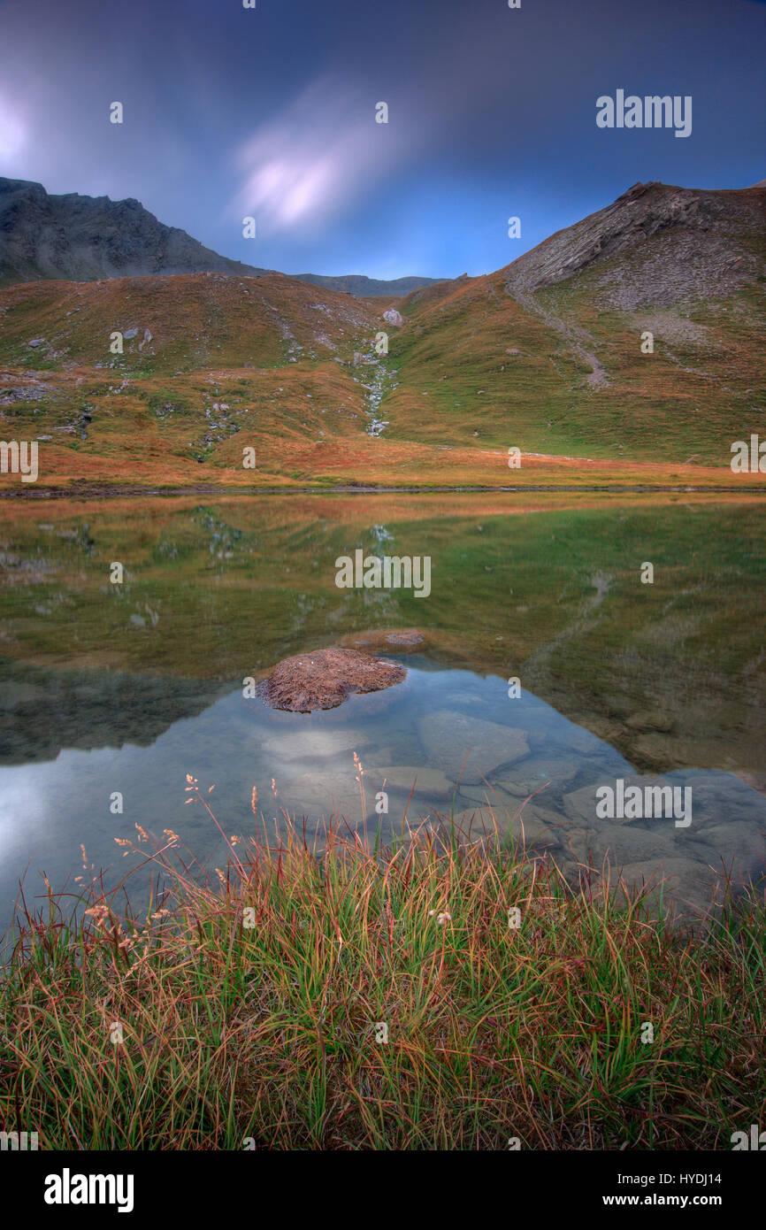 Just a small tarn I spotted while on my way up to the Col dell'Agnello, a pass in the Alps linking Italy to - Stock Image