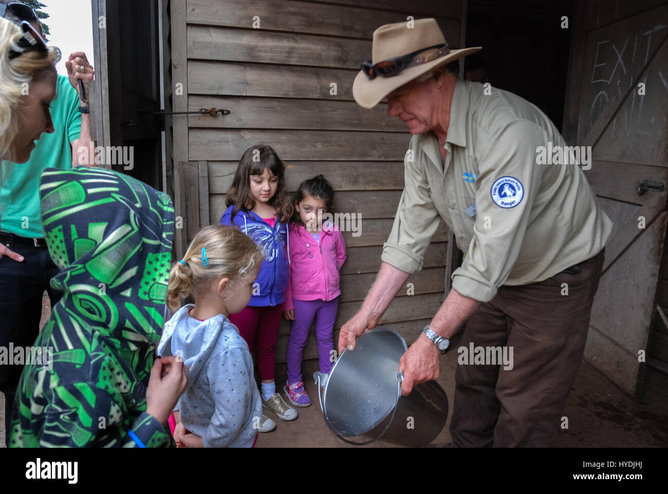 Children paying attention to dairy product at the Churchill Island Heritage Farm, Australia. - Stock Image