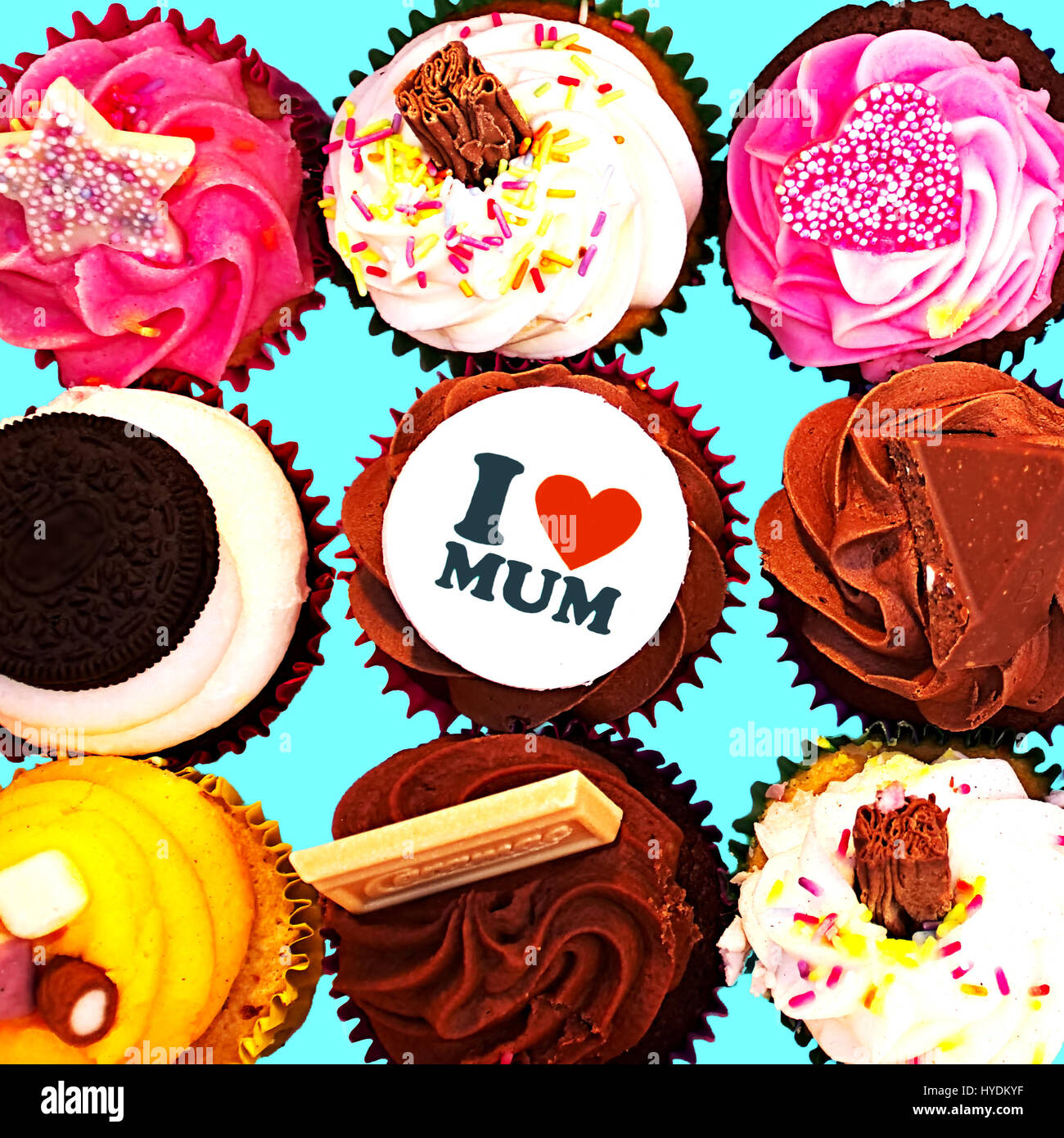 Cupcakes for mother day.Vibrant pastels in background. - Stock Image