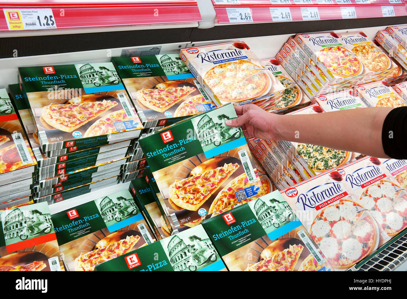 Own brand frozen pizza packings in a Kaufland hypermarket. - Stock Image