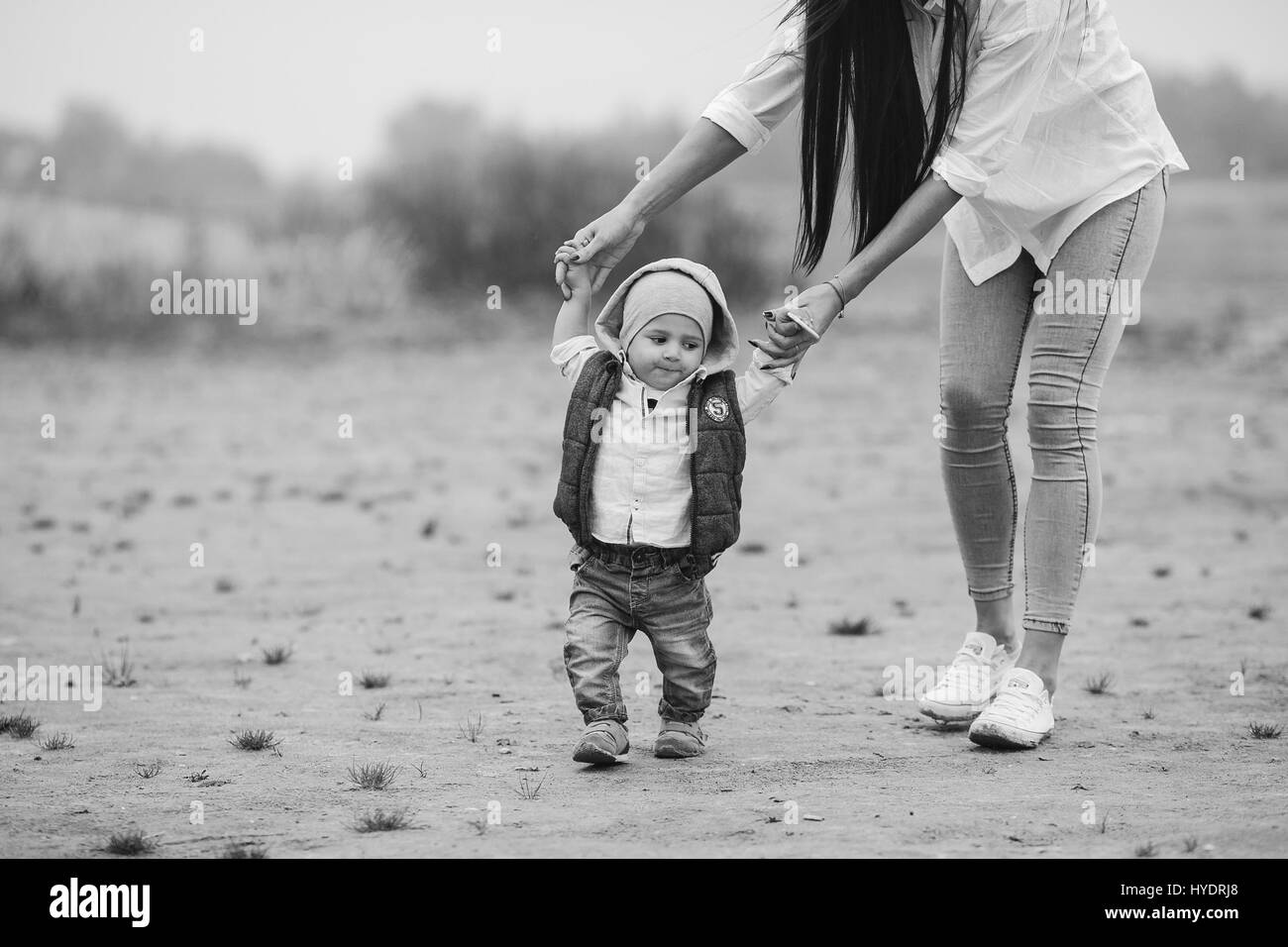 Mom with preteen child walking outdoor - Stock Image