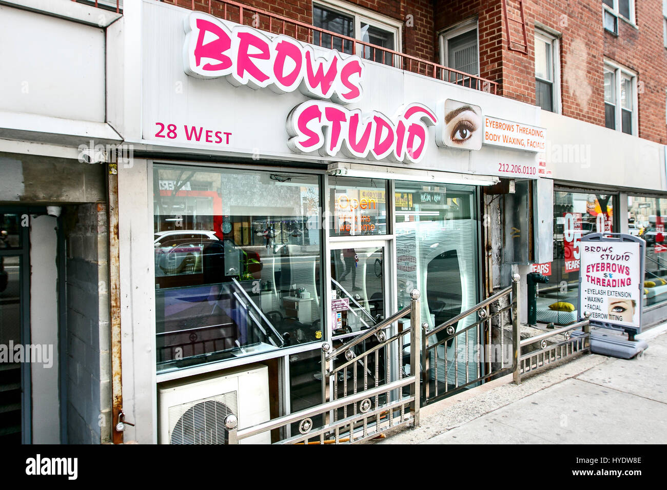 A small beauty salon on 14th street in Manhattan. - Stock Image