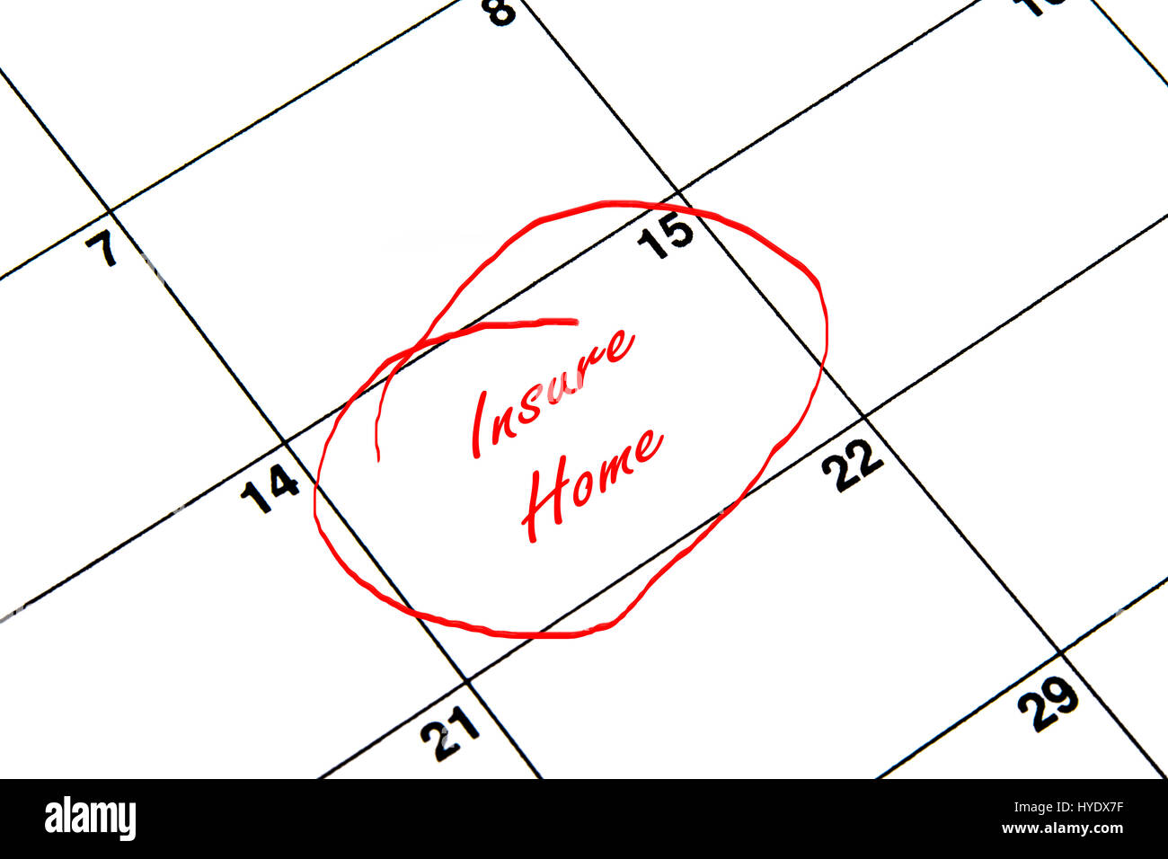 Insure Home Circled on A Calendar in Red - Stock Image