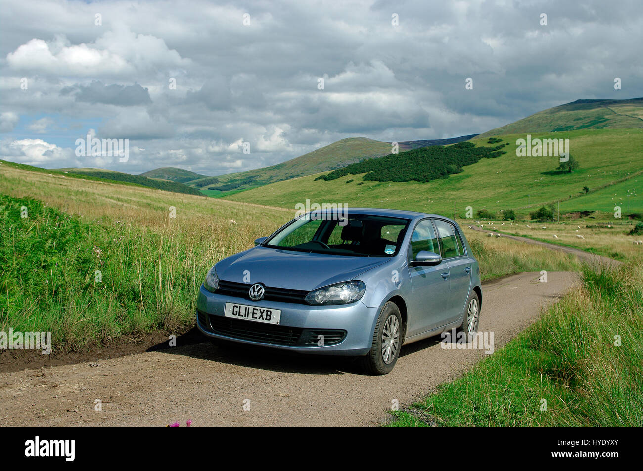 VW Golf TDi in the Cheviot Hills, Northumberland - Stock Image