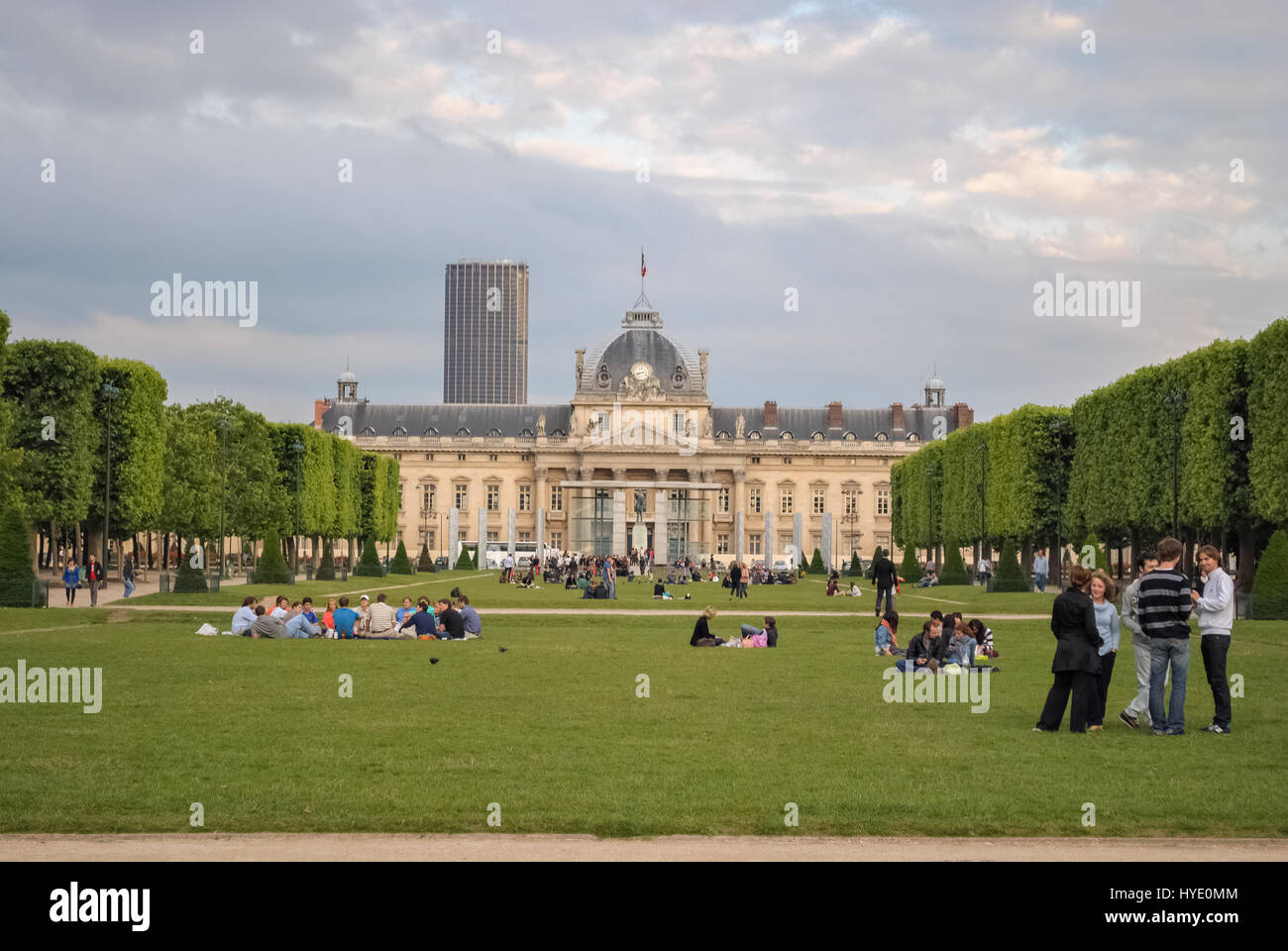 PARIS, FRANCE, June 18: Parisians and guests of the city rest on the lawn of the Champs de Mars on 18 June 2012. - Stock Image