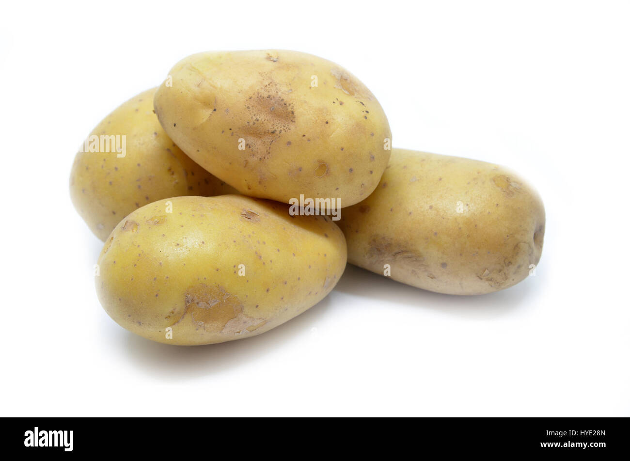 Ratte potatoes heap isolated on a white background Stock Photo
