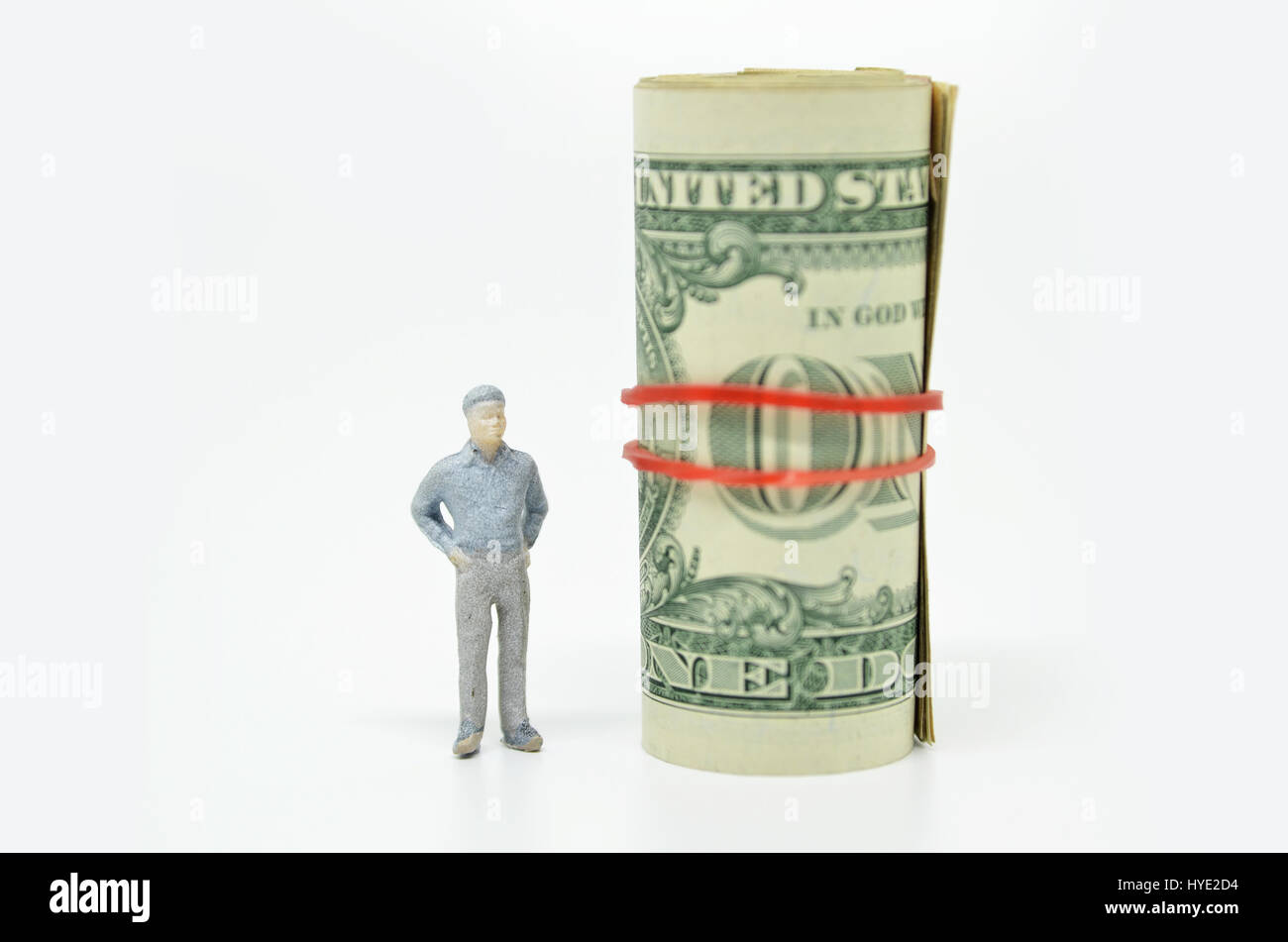Figure of businessman and one dollar bill. Wealth concept - Stock Image