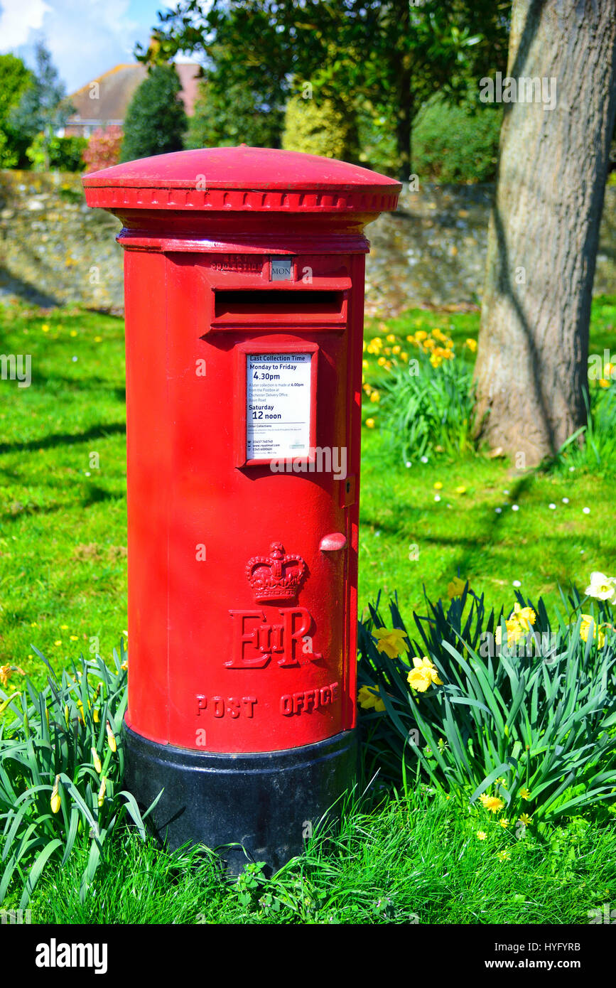 Red English letter or post box, West Wittering, Nr. Chichester, West Sussex, UK - Stock Image