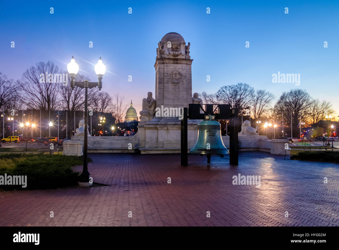 Liberty Bell replica in front of Union Station and Christopher Columbus statue at night - Washington, D.C., USA Stock Photo