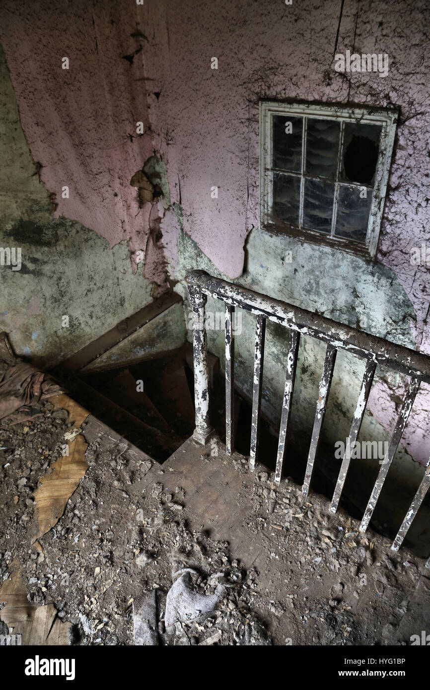 LICHFIELD, UK: A creepy staircase. THE MYSTERIOUS and decrepit remains of an abandoned animal rescue home have been - Stock Image