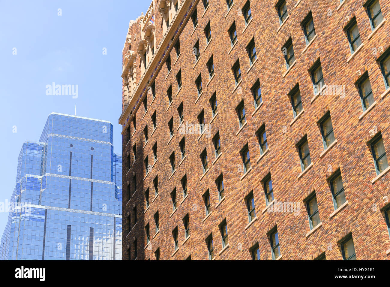 Kansas City, USA   May 21, 2016: Side View Of The Historic Hotel President  In The Power And Light District With The Modern One Kansas City Place Skysc