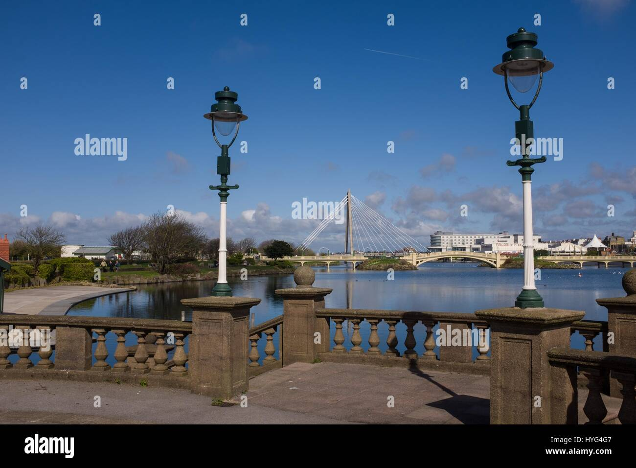 Marine Lake in Southport with Marine Way suspension bridge in background - Stock Image