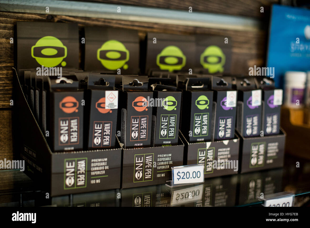 boxes of One brand vape pens on a shelf of a dispensary - Stock Image