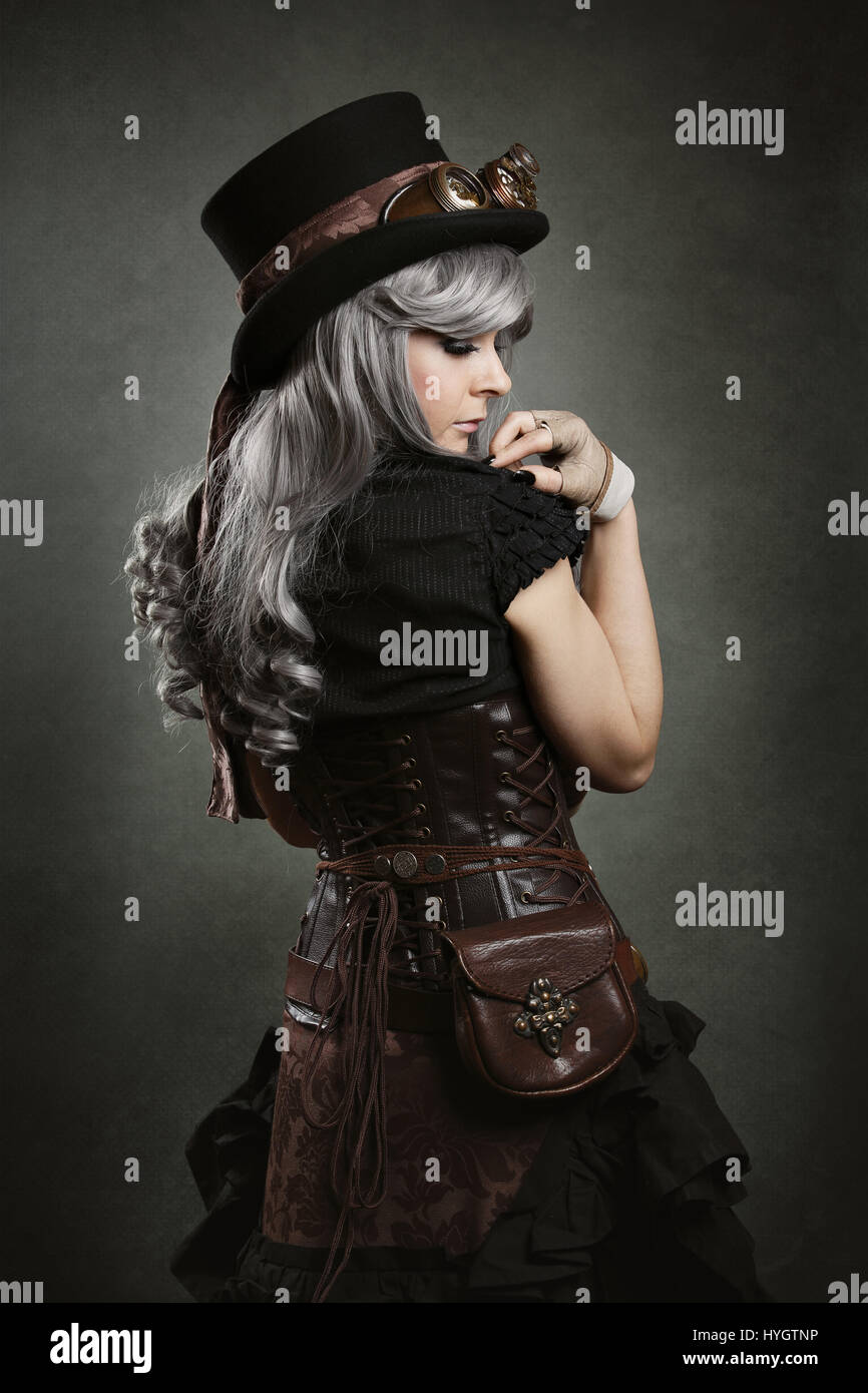 Steampunk woman back. Texture background - Stock Image