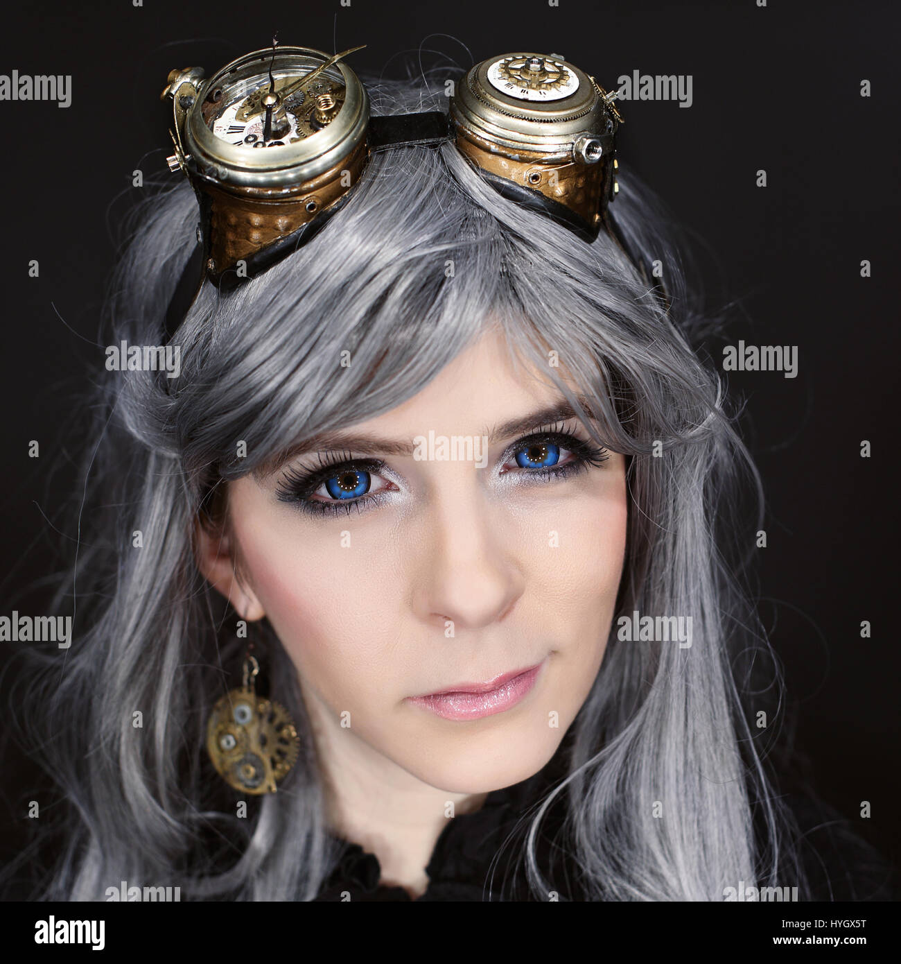 Beautiful woman portrait with steampunk glasses - Stock Image