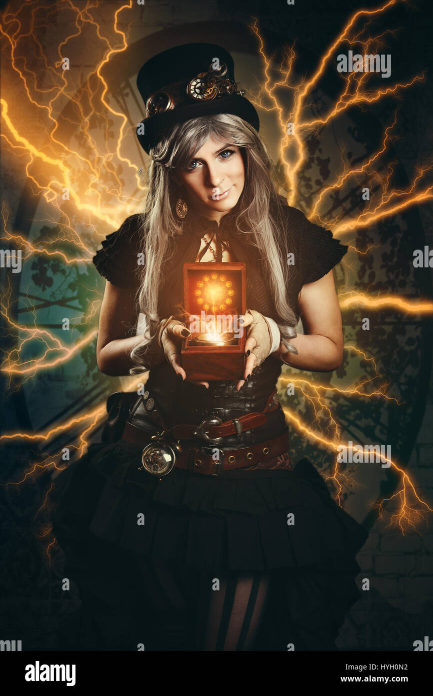 Steampunk time traveller with old compass - Stock Image