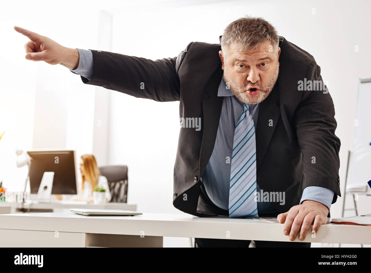 Furious manager arguing with his colleague - Stock Image