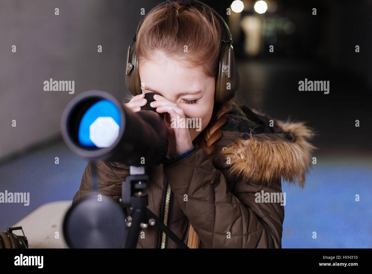 Nice cheerful girl wearing headphones - Stock Image
