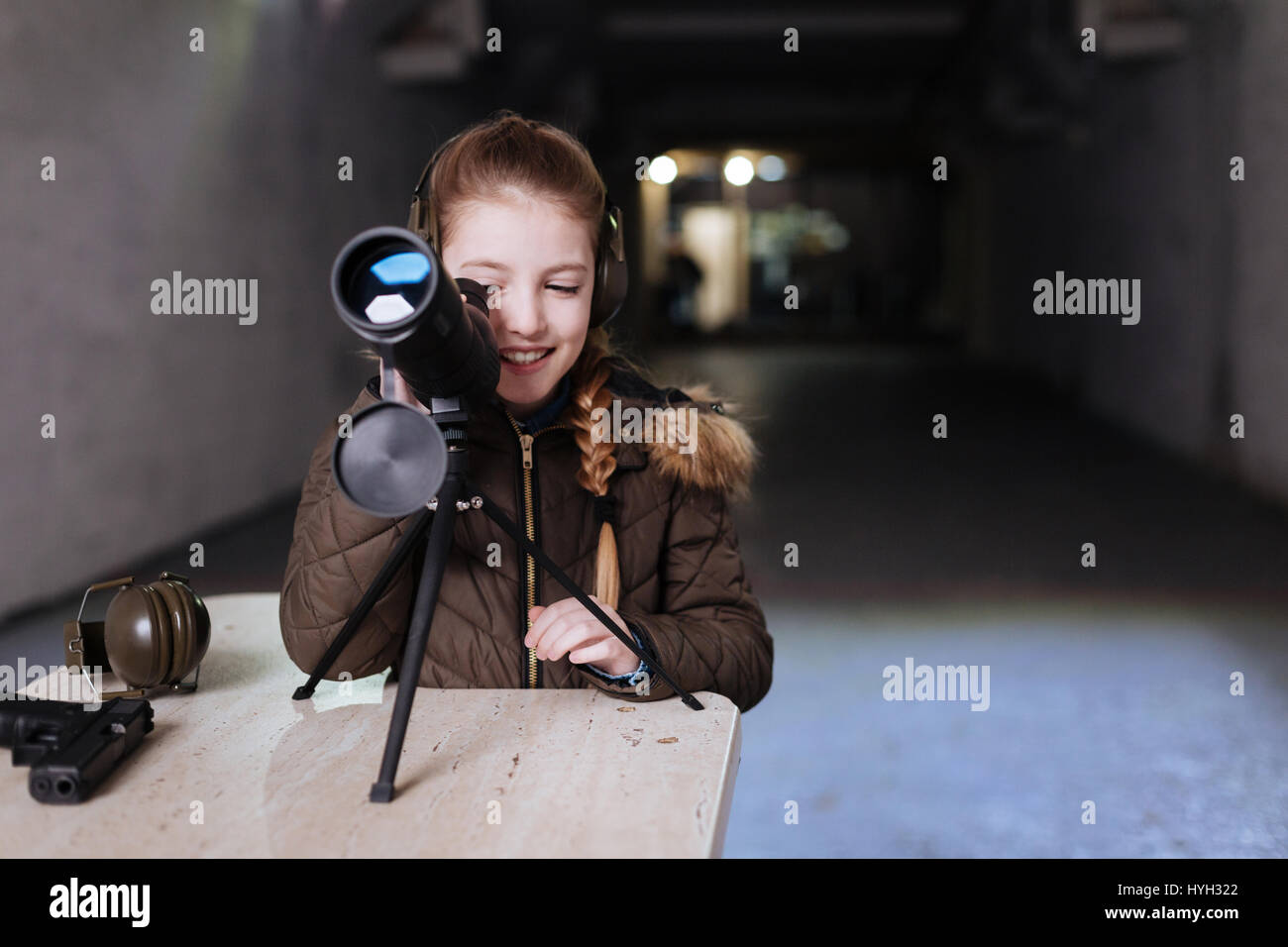 Delighted pretty girl using the telescope - Stock Image