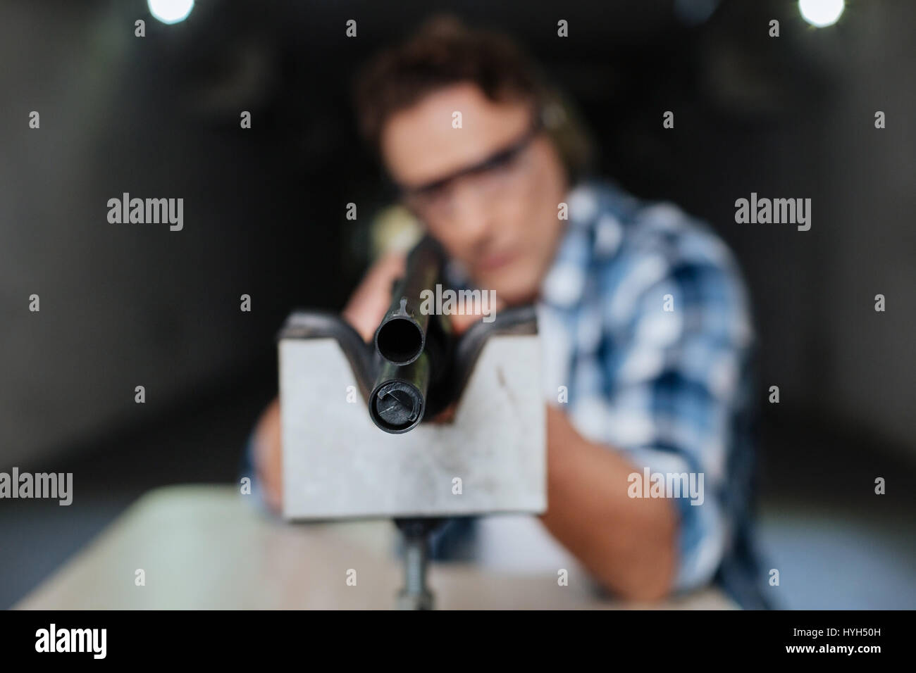 Confident professional marksman aiming at you - Stock Image