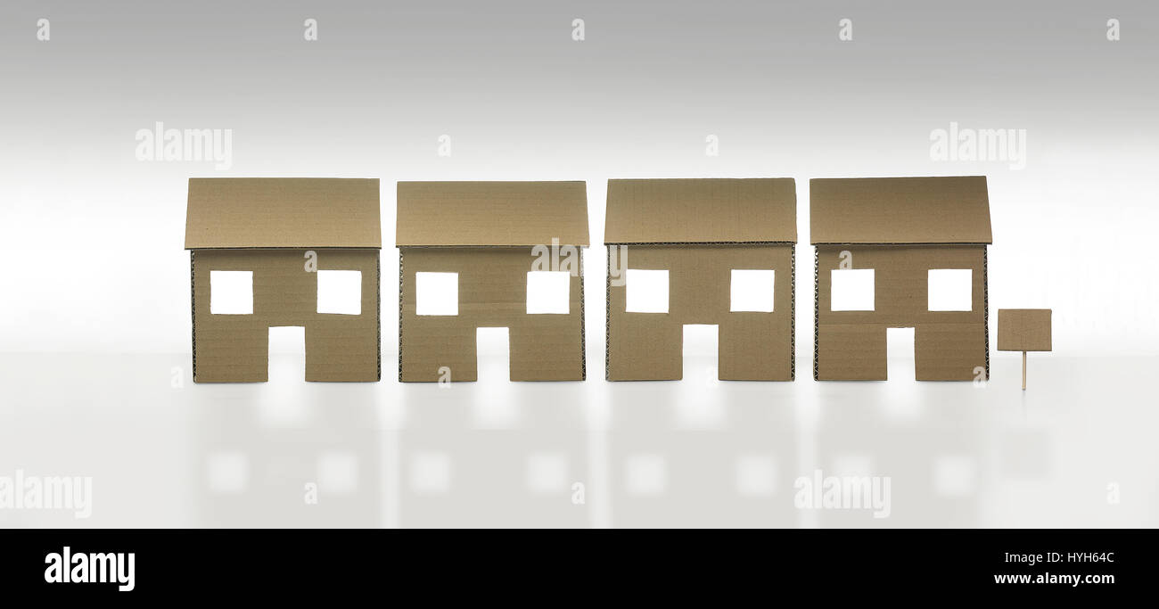 Row of Cardboard Houses with blank sign for artwork. - Stock Image