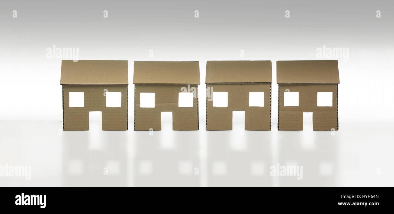Row of Cardboard Houses Stock Photo