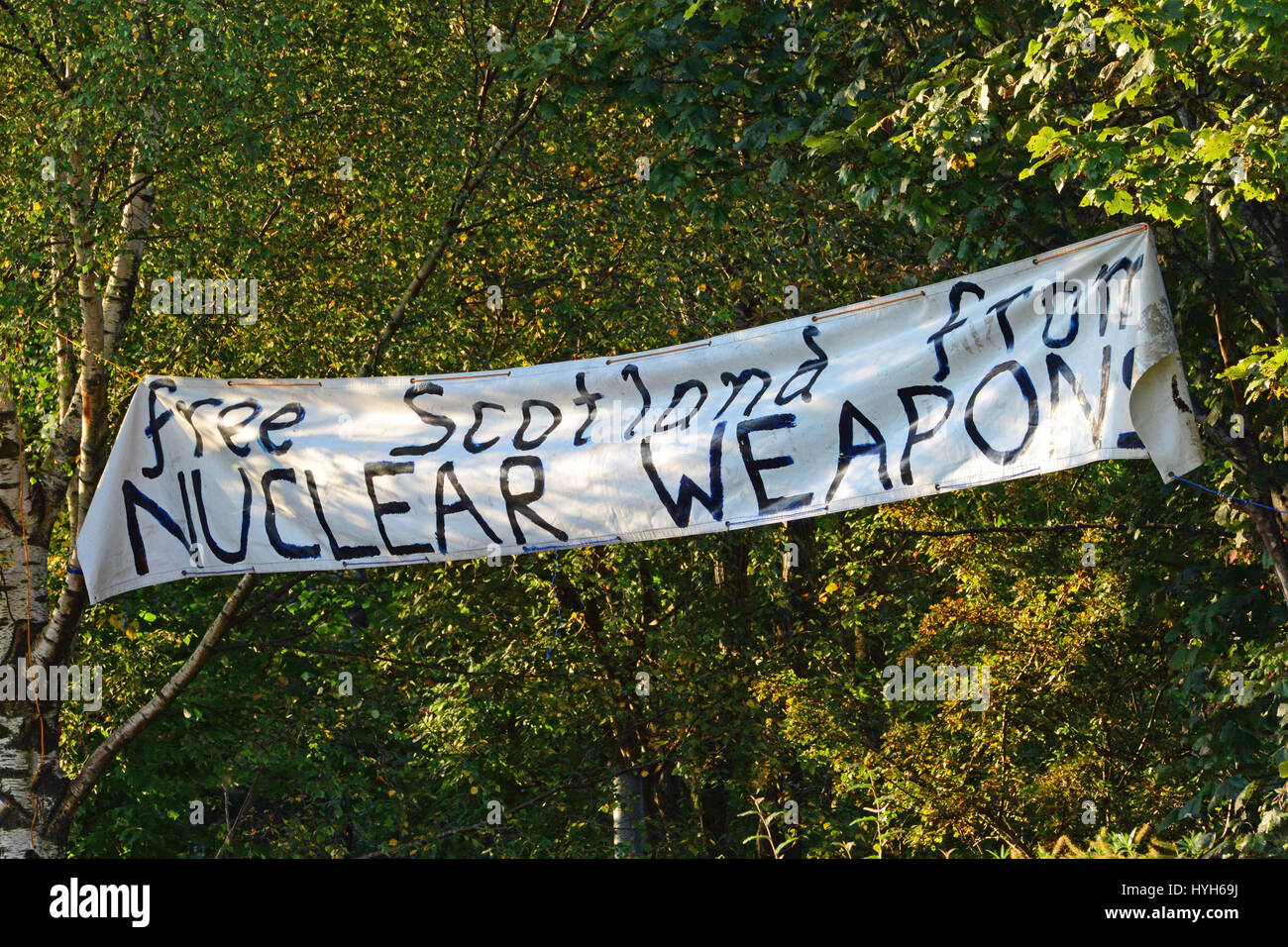An anti-Trident banner at the long-standing Faslane peace camp, close to HM Naval Base Clyde, home to Britain's Stock Photo