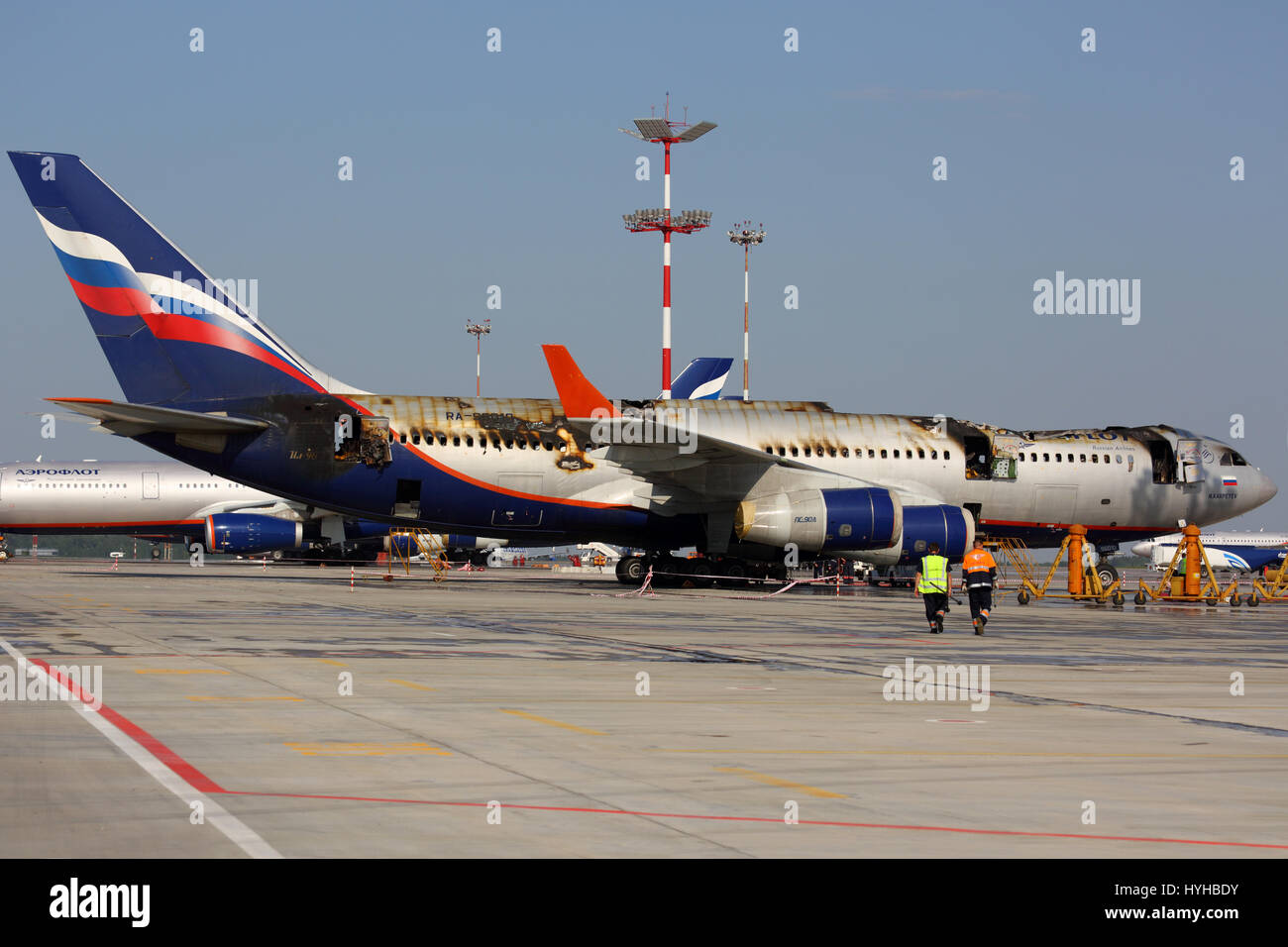 SHEREMETYEVO, MOSCOW REGION, RUSSIA - JUNE 3, 2014: Ilyushin IL-96-300 caught fire while standing at Sheremetyevo Stock Photo